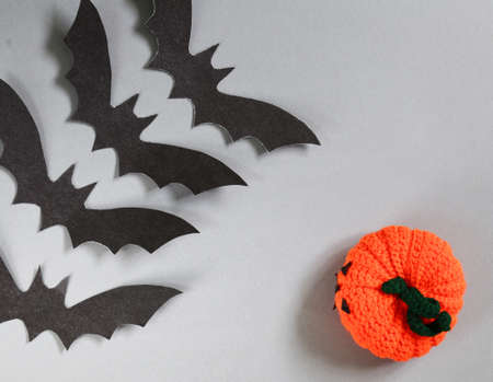 paper origami bats on a gray background, decorations for the holiday Halloween Stock Photo