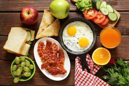 Traditional breakfast - eggs, bacon, toast and vegetables
