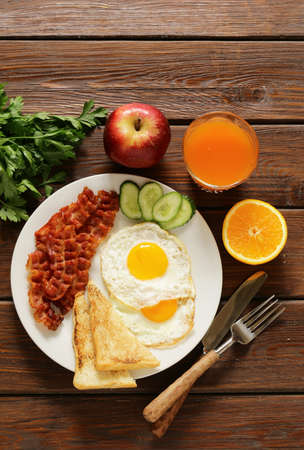 eggs and bacon: Traditional breakfast - eggs, bacon, toast and vegetables