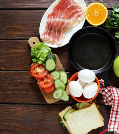 english cucumber: Traditional breakfast - eggs, bacon, toast and vegetables, fruit