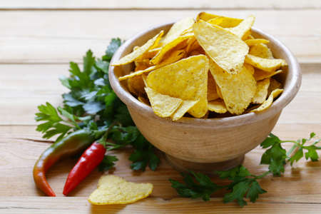 corn chips: corn chips, nachos in a bowl on the table Stock Photo