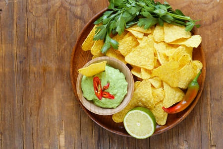corn chips: dip of avocado guacamole and corn chips, Mexican food