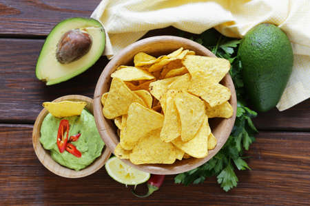 cilantro: dip of avocado guacamole and corn chips, Mexican food