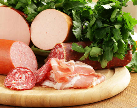 delicacy: smoked sausage delicacy salami on a wooden board Stock Photo