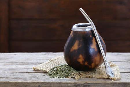 yerba mate: Traditional yerba mate tea in calabash mug and bombilla