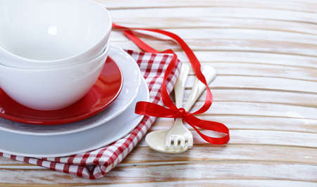 serving utensil: clean empty dishes cups and plates on wooden background