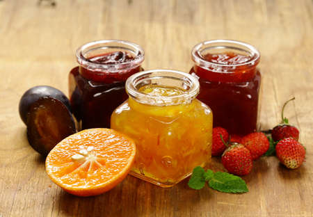 canning: Assorted berries and fruit jams. Homemade canning. Fresh berries and fruits