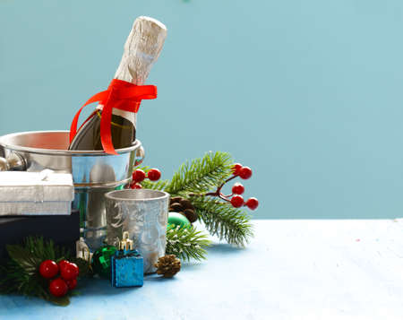 Christmas still life. Champagne, Christmas decorations and gifts.