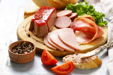 Assorted deli meats - ham, salami, parma, prosciutto, pate Stock Photo