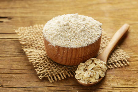 Natural organic Oat flour in a wooden bowl