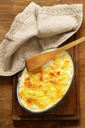 Traditional French potato gratin with cream and cheese