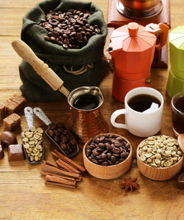 Still life of coffee - green and brown beans and spices, cinnamon and anise Stock Photo