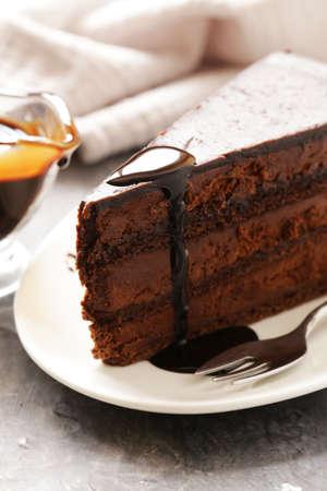 Dessert super chocolate cake on a white plate
