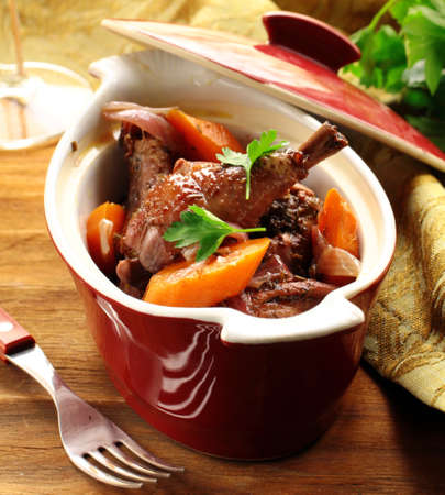 slow stew the cock in red wine with vegetables Stock Photo