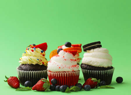 blueberry muffin: festive cupcakes with berries and butter cream