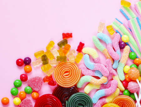 Colorful candy and fruit jelly sweets on a pink background Stock Photo