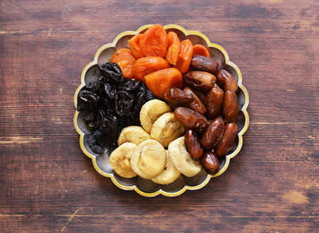 Assorted various dried fruits (dried apricots, prunes, figs) Stock Photo