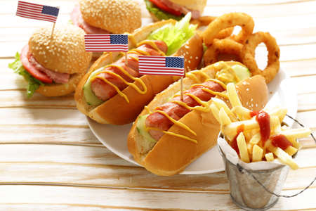 Traditional  hot dog, french fries and onion rings food for the celebration of July 4 - Independence Day of America Stock Photo