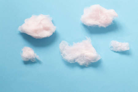 Sweet pink cotton candy on a blue background
