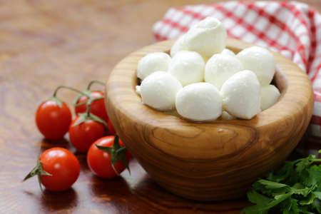 Italian soft mozzarella cheese on a wooden table Standard-Bild