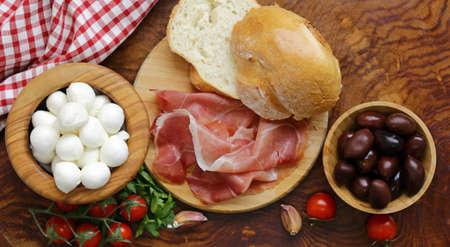 hams: Italian food - olives, parma ham, tomatoes, mozzarella cheese