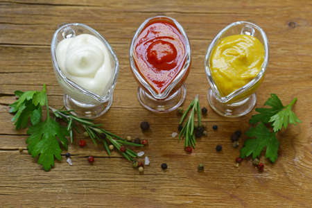 Different types of sauces in glass gravies Banque d'images