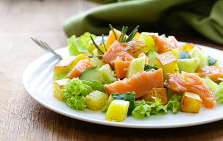 Salad with fish, potatoes and fresh cucumbers