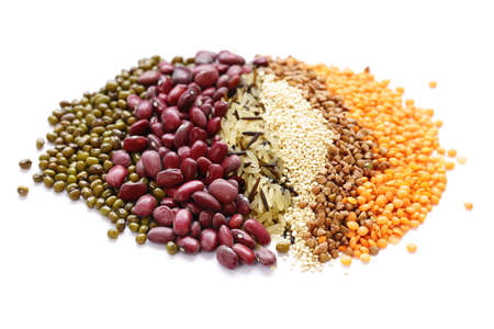 different cereals - beans, lentils, rice on a white background