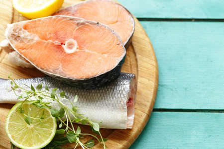 raw fish sea bass and salmon with lemon and herbs