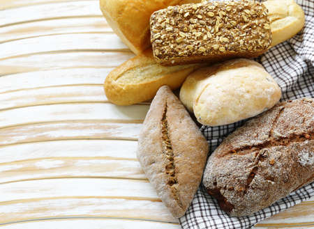 natural organic bread assortment on a wooden background Stock Photo