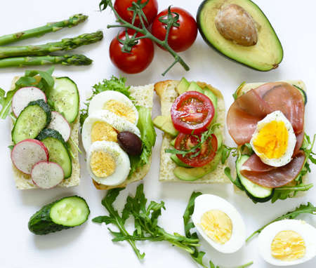 sandwiches with different fillings - vegetables, ham and egg Stock Photo