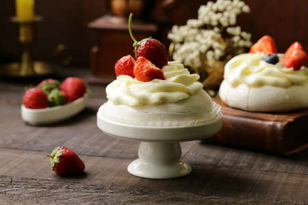 Meringue pavlova cake with berries and butter cream