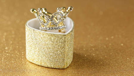 precious crown on a gold background Stock Photo
