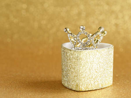 precious crown on a gold background Stockfoto