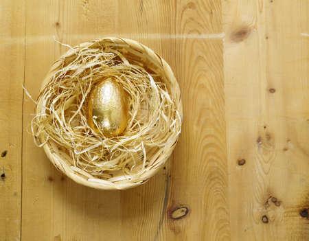 golden egg symbol of wealth Stock Photo