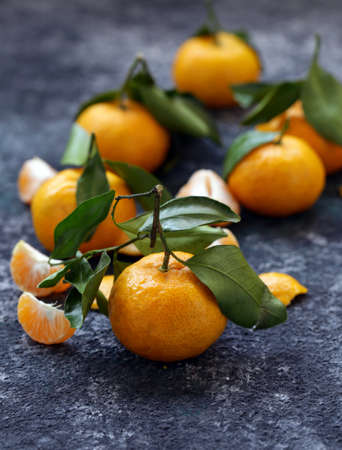 ripe organic tangerines with green leaves