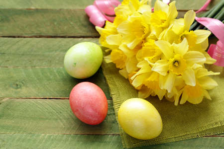 yellow daffodils and decorated eggs for Easter