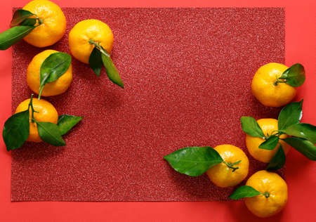 tangerines on a red background, chinese new year Stock fotó