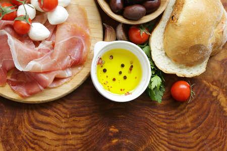 Italian food - olives, parma ham, tomatoes, mozzarella cheese