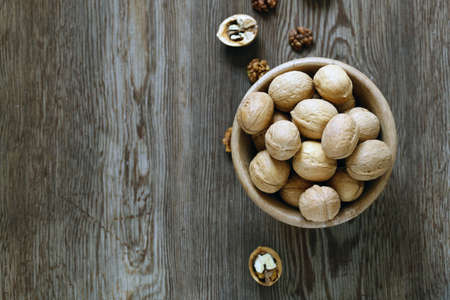 walnuts for a healthy diet on a wooden table Imagens