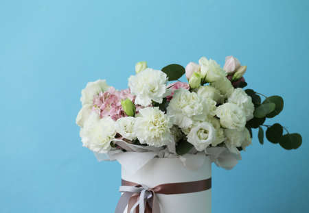 delightful bouquet of white and pink colors in a gift box