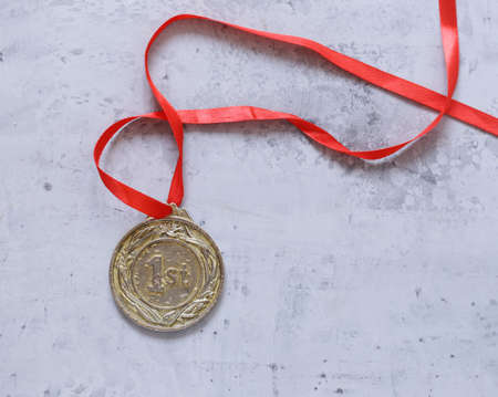 gold medal with red ribbon, victory and first place