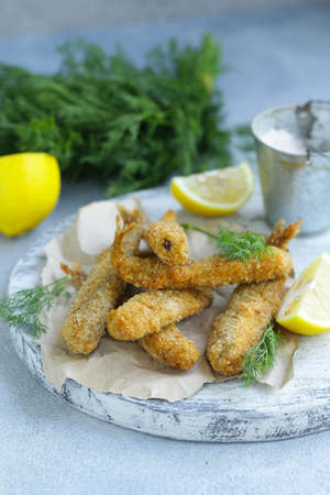 fried fish for lunch, with lemon and herbs Banco de Imagens