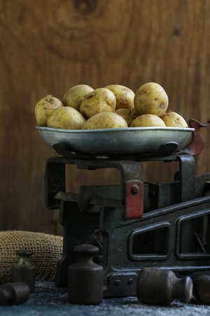 organic vegetables, potatoes on a wooden background Imagens