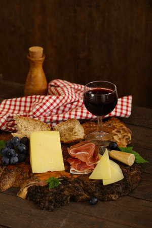 cheeseboard on a wooden table, rustic style Stock fotó