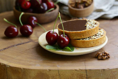 chocolate tartlets with berries and nuts