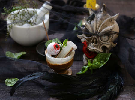 autumn still life for halloween - the witch brews a potion