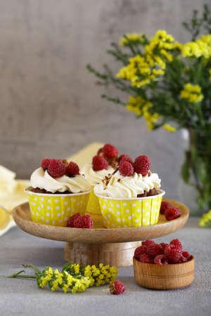 cream cupcakes with raspberries for dessert Stock Photo