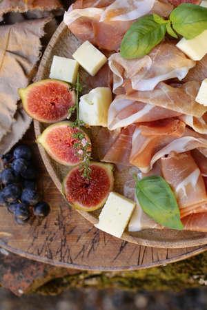 italian appetizer antipasti, cheese, ham and fruit 版權商用圖片