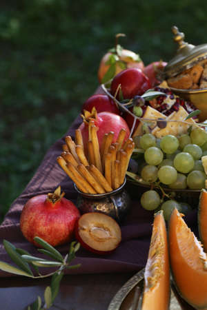 festive autumn table setting with fruits and cheese Stock Photo